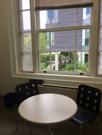 Image depcits a sunny window and a round table with three chairs